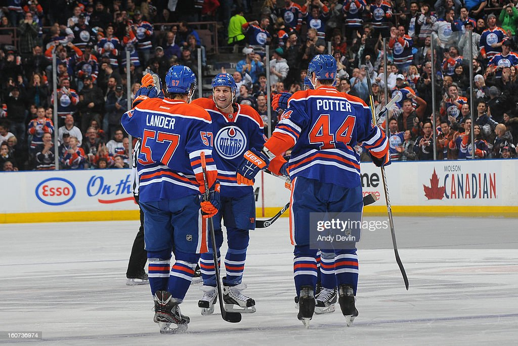 Ryan Smyth #94, Anton Lander #57 and Corey Potter #44 of the Edmonton Oilers skates on the ice in an NHL game against the Vancouver Canucks on February 4, 2013 at Rexall Place in Edmonton, Alberta, Canada.