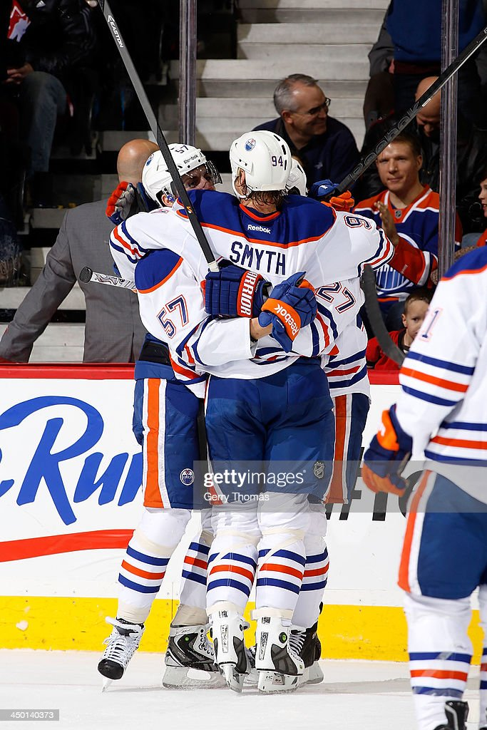 <a gi-track='captionPersonalityLinkClicked' href=/galleries/search?phrase=Ryan+Smyth+-+Ice+Hockey+Player&family=editorial&specificpeople=202567 ng-click='$event.stopPropagation()'>Ryan Smyth</a> #94, <a gi-track='captionPersonalityLinkClicked' href=/galleries/search?phrase=David+Perron&family=editorial&specificpeople=4282591 ng-click='$event.stopPropagation()'>David Perron</a> #57 and teammates of the Edmonton Oilers celebrate a goal against the Calgary Flames at Scotiabank Saddledome on November 16, 2013 in Calgary, Alberta, Canada.