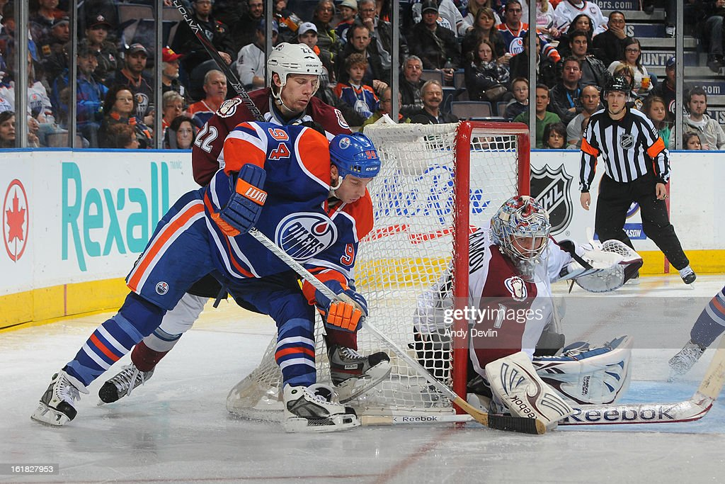 <a gi-track='captionPersonalityLinkClicked' href=/galleries/search?phrase=Ryan+Smyth+-+Ice+Hockey+Player&family=editorial&specificpeople=202567 ng-click='$event.stopPropagation()'>Ryan Smyth</a> #94 of the Edmonton Oilers battles behind the net against <a gi-track='captionPersonalityLinkClicked' href=/galleries/search?phrase=Matt+Hunwick&family=editorial&specificpeople=2284766 ng-click='$event.stopPropagation()'>Matt Hunwick</a> #22 of the Colorado Avalanche on February 16, 2013 at Rexall Place in Edmonton, Alberta, Canada.