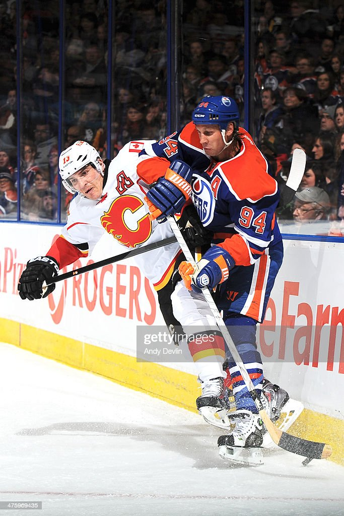 <a gi-track='captionPersonalityLinkClicked' href=/galleries/search?phrase=Ryan+Smyth+-+Ice+Hockey+Player&family=editorial&specificpeople=202567 ng-click='$event.stopPropagation()'>Ryan Smyth</a> #94 of the Edmonton Oilers battles for the puck against <a gi-track='captionPersonalityLinkClicked' href=/galleries/search?phrase=Mike+Cammalleri&family=editorial&specificpeople=634009 ng-click='$event.stopPropagation()'>Mike Cammalleri</a> #13 of the Calgary Flames on March 1, 2014 at Rexall Place in Edmonton, Alberta, Canada.