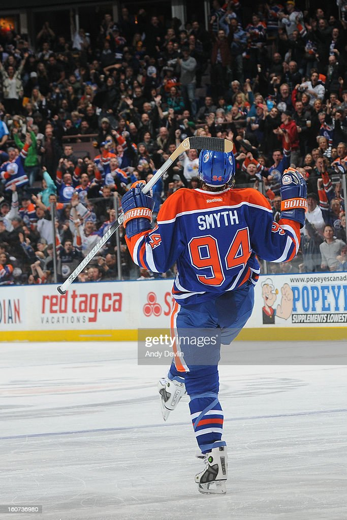 Ryan Smyth #94 of the Edmonton Oilers celebrates after scoring a goal in an NHL game against the Vancouver Canucks on February 4, 2013 at Rexall Place in Edmonton, Alberta, Canada.