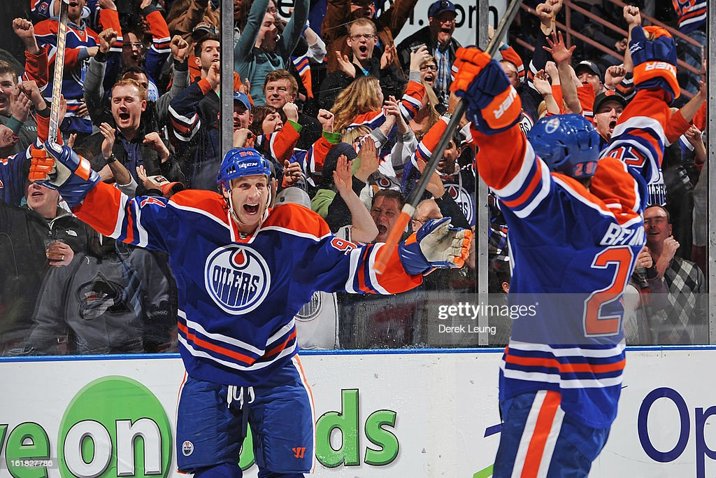 <a gi-track='captionPersonalityLinkClicked' href=/galleries/search?phrase=Ryan+Smyth+-+Ice+Hockey+Player&family=editorial&specificpeople=202567 ng-click='$event.stopPropagation()'>Ryan Smyth</a> #94 of the Edmonton Oilers celebrates the goal of his teammate Magnus Paajarvi #91 (not pictured) on Semyon Varlamov #1 of the Colorado Avalanche during the NHL game at Rexall Place on February 16, 2013 in Edmonton, Alberta, Canada. Oilers won 6-4.