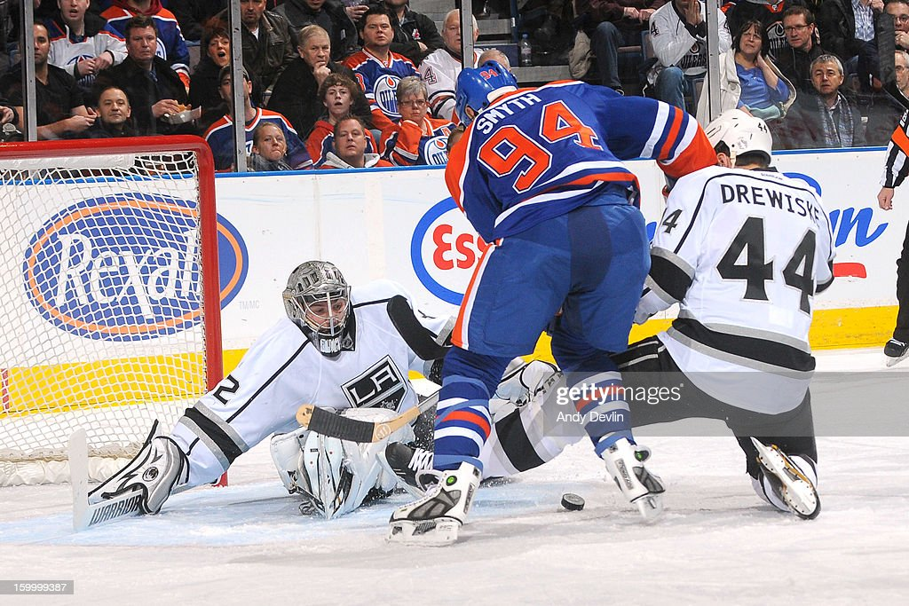 Ryan Smyth #94 of the Edmonton Oilers drives hard to the net battling for position against Davis Drewiske #44 of the Los Angeles Kings at Rexall Place on January 24, 2013 in Edmonton, Alberta, Canada.