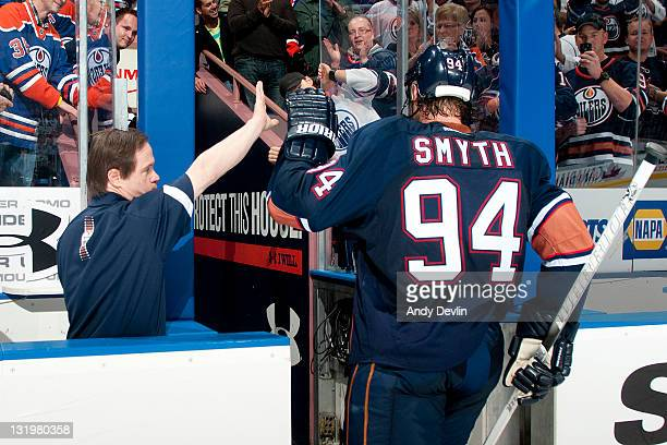 Ryan Smyth of the Edmonton Oilers gets a high five from Oilers' equipment assistant Joy Moss after a win against the St Louis Blues at Rexall Place...