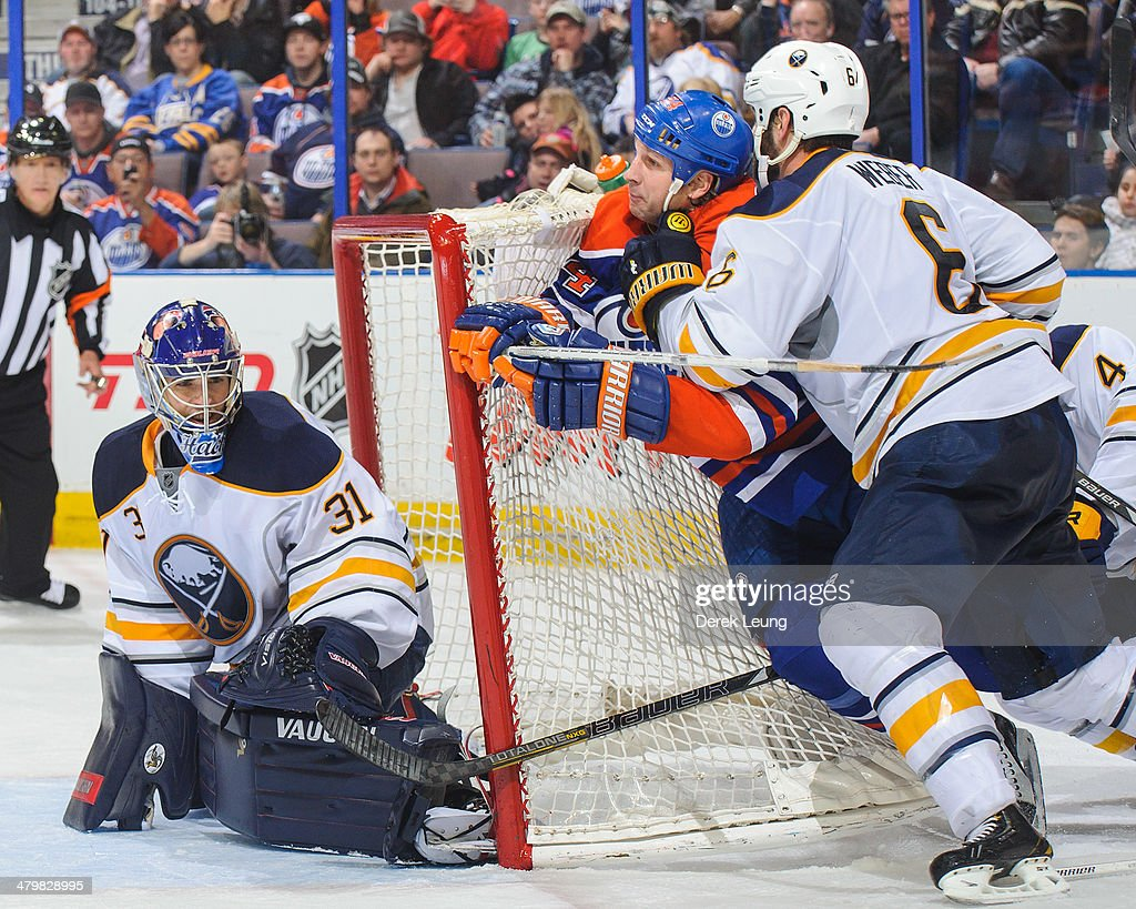 Ryan Smyth #94 of the Edmonton Oilers gets checked by Mike Weber #6 of the Buffalo Sabres in front of the net of Matt Hackett #31 during an NHL game at Rexall Place on March 20, 2014 in Edmonton, Alberta, Canada.