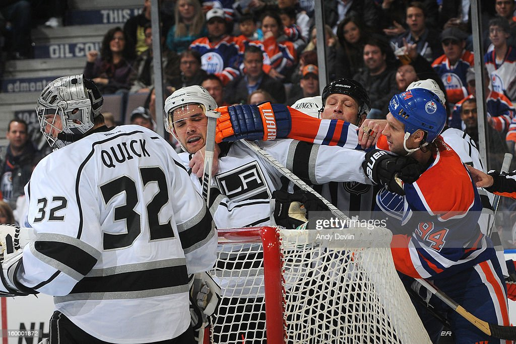 Ryan Smyth #94 of the Edmonton Oilers gets involved in a scrum with Alec Martinez #27 of the Los Angeles Kings at Rexall Place on January 24, 2013 in Edmonton, Alberta, Canada.