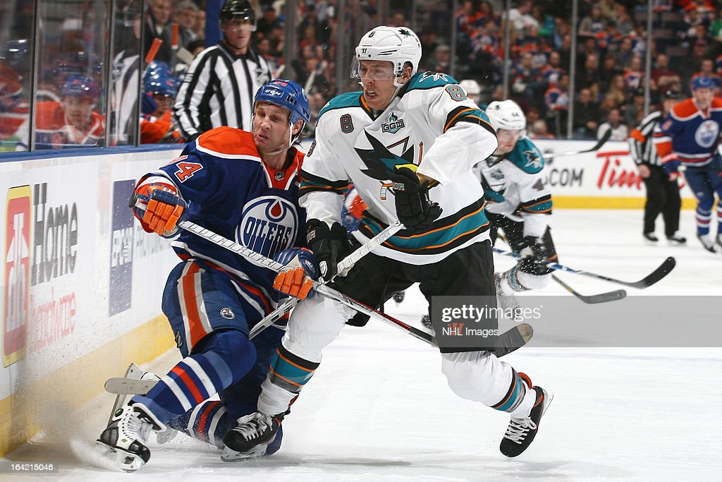 <a gi-track='captionPersonalityLinkClicked' href=/galleries/search?phrase=Ryan+Smyth+-+Ice+Hockey+Player&family=editorial&specificpeople=202567 ng-click='$event.stopPropagation()'>Ryan Smyth</a> #94 of the Edmonton Oilers is checked into the boards by <a gi-track='captionPersonalityLinkClicked' href=/galleries/search?phrase=Joe+Pavelski&family=editorial&specificpeople=687042 ng-click='$event.stopPropagation()'>Joe Pavelski</a> of the San Jose Sharks on March 20, 2013 at Rexall Place in Edmonton, Alberta, Canada.