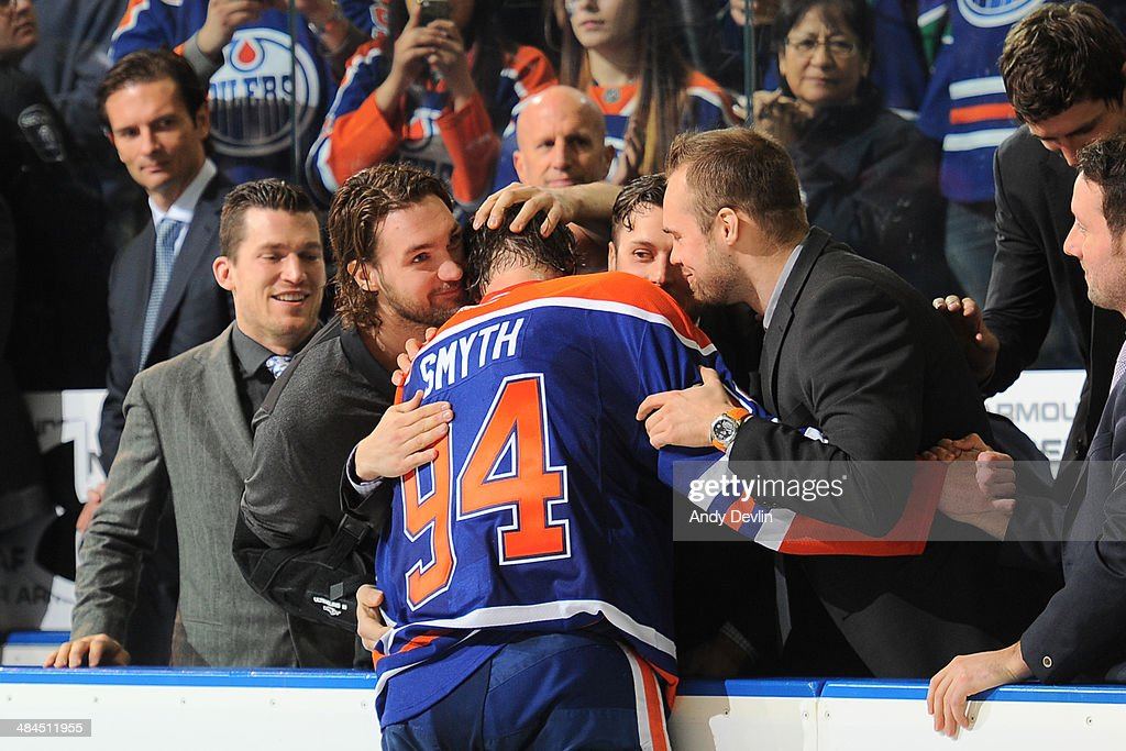 <a gi-track='captionPersonalityLinkClicked' href=/galleries/search?phrase=Ryan+Smyth+-+Ice+Hockey+Player&family=editorial&specificpeople=202567 ng-click='$event.stopPropagation()'>Ryan Smyth</a> #94 of the Edmonton Oilers is congratulated by his team mates following his final NHL game against the Vancouver Canucks on April 12, 2014 at Rexall Place in Edmonton, Alberta, Canada.