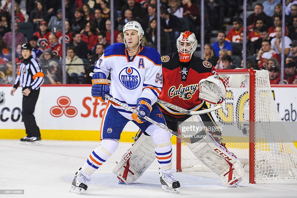 <a gi-track='captionPersonalityLinkClicked' href=/galleries/search?phrase=Ryan+Smyth+-+Ice+Hockey+Player&family=editorial&specificpeople=202567 ng-click='$event.stopPropagation()'>Ryan Smyth</a> #94 of the Edmonton Oilers looks for an opportunity in front of Reto Berra #29 of the Calgary Flames during an NHL game at Scotiabank Saddledome on November 16, 2013 in Calgary, Alberta, Canada.