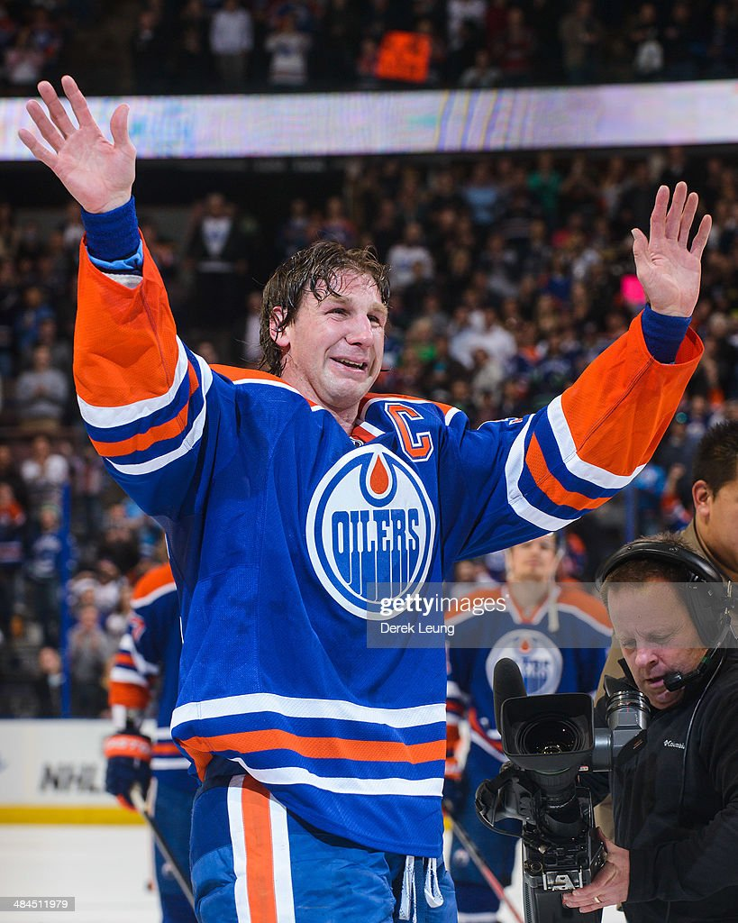 <a gi-track='captionPersonalityLinkClicked' href=/galleries/search?phrase=Ryan+Smyth+-+Ice+Hockey+Player&family=editorial&specificpeople=202567 ng-click='$event.stopPropagation()'>Ryan Smyth</a> #94 of the Edmonton Oilers salutes the crowd after his last NHL game after defeating the Vancouver Canucks at Rexall Place on April 12, 2014 in Edmonton, Alberta, Canada.