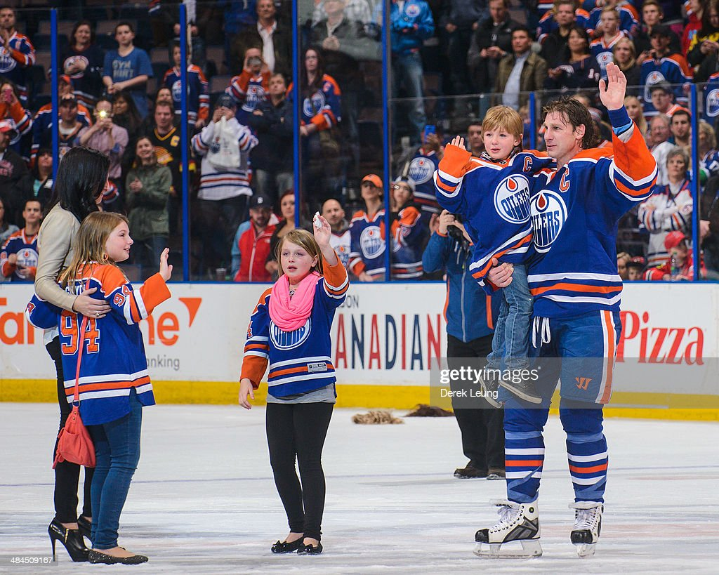 <a gi-track='captionPersonalityLinkClicked' href=/galleries/search?phrase=Ryan+Smyth+-+Ice+Hockey+Player&family=editorial&specificpeople=202567 ng-click='$event.stopPropagation()'>Ryan Smyth</a> #94 of the Edmonton Oilers salutes the crowd along with his family after his last NHL game after defeating the Vancouver Canucks at Rexall Place on April 12, 2014 in Edmonton, Alberta, Canada.