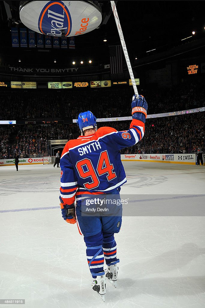 <a gi-track='captionPersonalityLinkClicked' href=/galleries/search?phrase=Ryan+Smyth+-+Ice+Hockey+Player&family=editorial&specificpeople=202567 ng-click='$event.stopPropagation()'>Ryan Smyth</a> #94 of the Edmonton Oilers salutes to fans following his final NHL game against the Vancouver Canucks on April 12, 2014 at Rexall Place in Edmonton, Alberta, Canada.