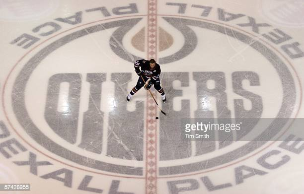 Ryan Smyth of the Edmonton Oilers skates across a large Oilers logo during warm up before NHL action against the Detroit Red Wings in game three of...