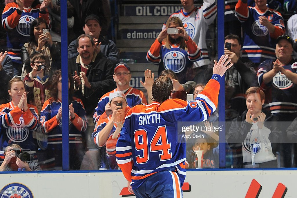 <a gi-track='captionPersonalityLinkClicked' href=/galleries/search?phrase=Ryan+Smyth+-+Ice+Hockey+Player&family=editorial&specificpeople=202567 ng-click='$event.stopPropagation()'>Ryan Smyth</a> #94 of the Edmonton Oilers waves to fans following his final NHL game against the Vancouver Canucks on April 12, 2014 at Rexall Place in Edmonton, Alberta, Canada.