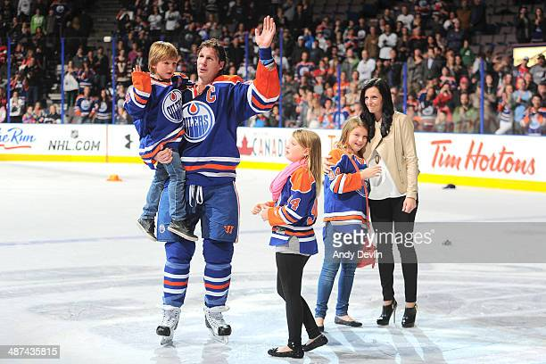 Ryan Smyth of the Edmonton Oilers waves to fans following his final career NHL game against the Vancouver Canucks on April 12 2014 at Rexall Place in...