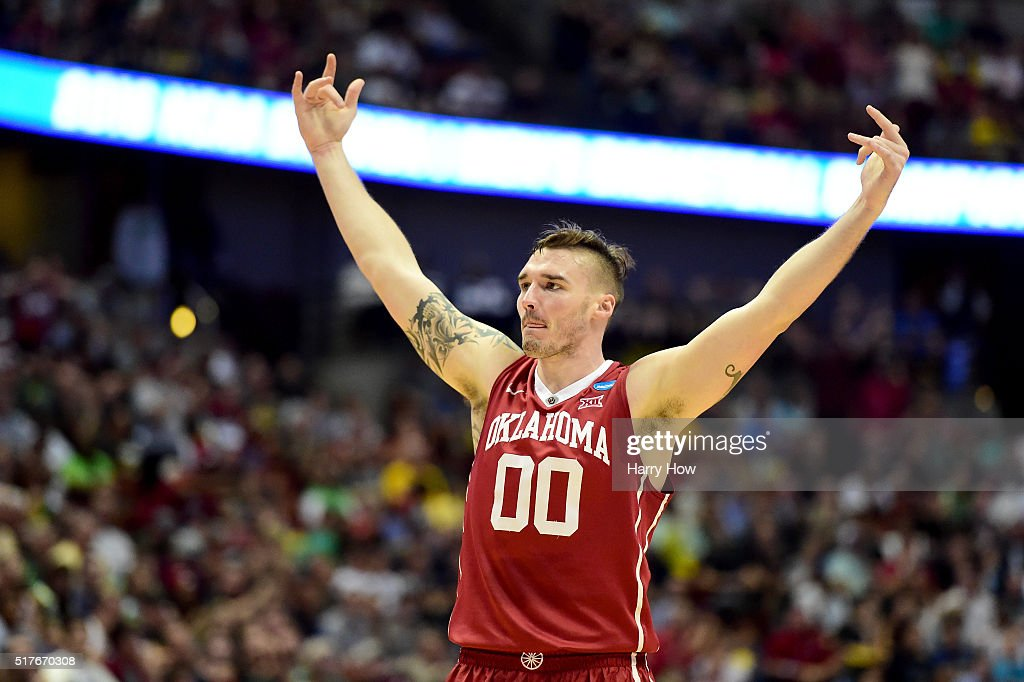 Ryan Spangler #00 of the Oklahoma Sooners celebrates in the first half while taking on the Oregon Ducks in the NCAA Men's Basketball Tournament West Regional Final at Honda Center on March 26, 2016 in Anaheim, California.