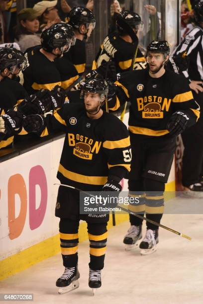 Ryan Spooner and Drew Stafford of the Boston Bruins celebrate a goal against the New Jersey Devils at the TD Garden on March 4 2017 in Boston...