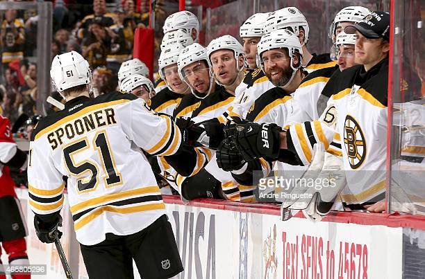 Ryan Spooner of the Boston Bruins celebrates his first of two second period goals against the Ottawa Senators with teammates at the players' bench...