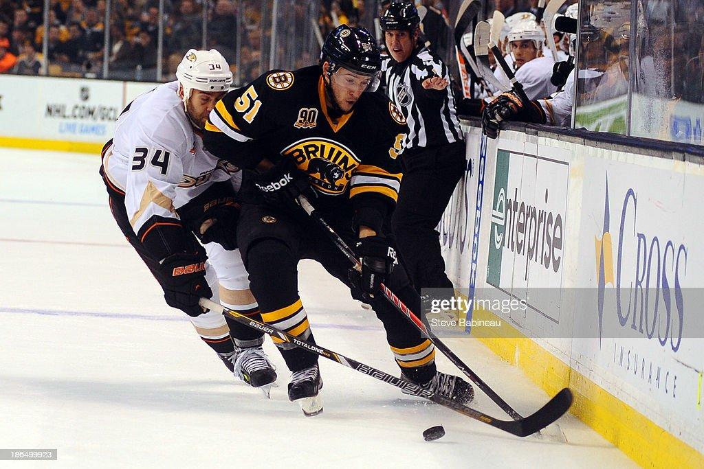 Ryan Spooner #51 of the Boston Bruins handles the puck against Daniel Winnik #34 of the Anaheim Ducks at the TD Garden on October 31, 2013 in Boston, Massachusetts.