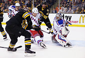Ryan Spooner of the Boston Bruins scores a goal against Henrik Lundqvist of the New York Rangers during the third period at TD Garden on November 27...