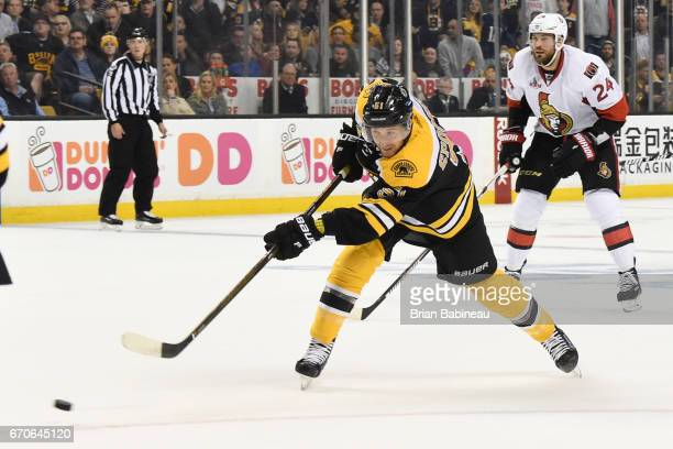 Ryan Spooner of the Boston Bruins shoots the puck against the Ottawa Senators in Game Four of the Eastern Conference First Round during the 2017 NHL...