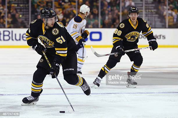 Ryan Spooner of the Boston Bruins skates against the Buffalo Sabres during the third period at TD Garden on March 17 2015 in Boston Massachusetts
