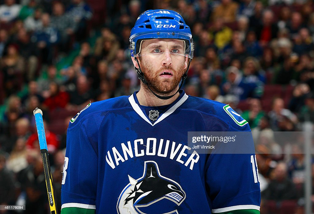 Ryan Stanton of the Vancouver Canucks looks on from the bench during their NHL game against the New York Islanders at Rogers Arena January 6 2015 in...