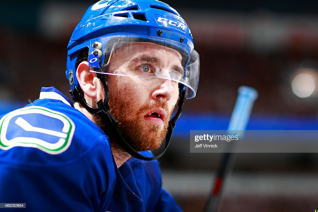 Ryan Stanton of the Vancouver Canucks looks on from the bench during their NHL game against the Pittsburgh Penguins at Rogers Arena February 7 2015...
