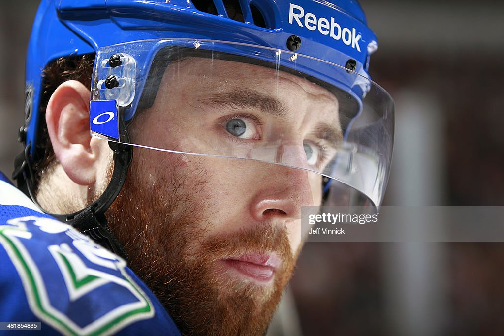 Ryan Stanton of the Vancouver Canucks looks on from the bench during their NHL game against the Anaheim Ducks at Rogers Arena March 29 2014 in...