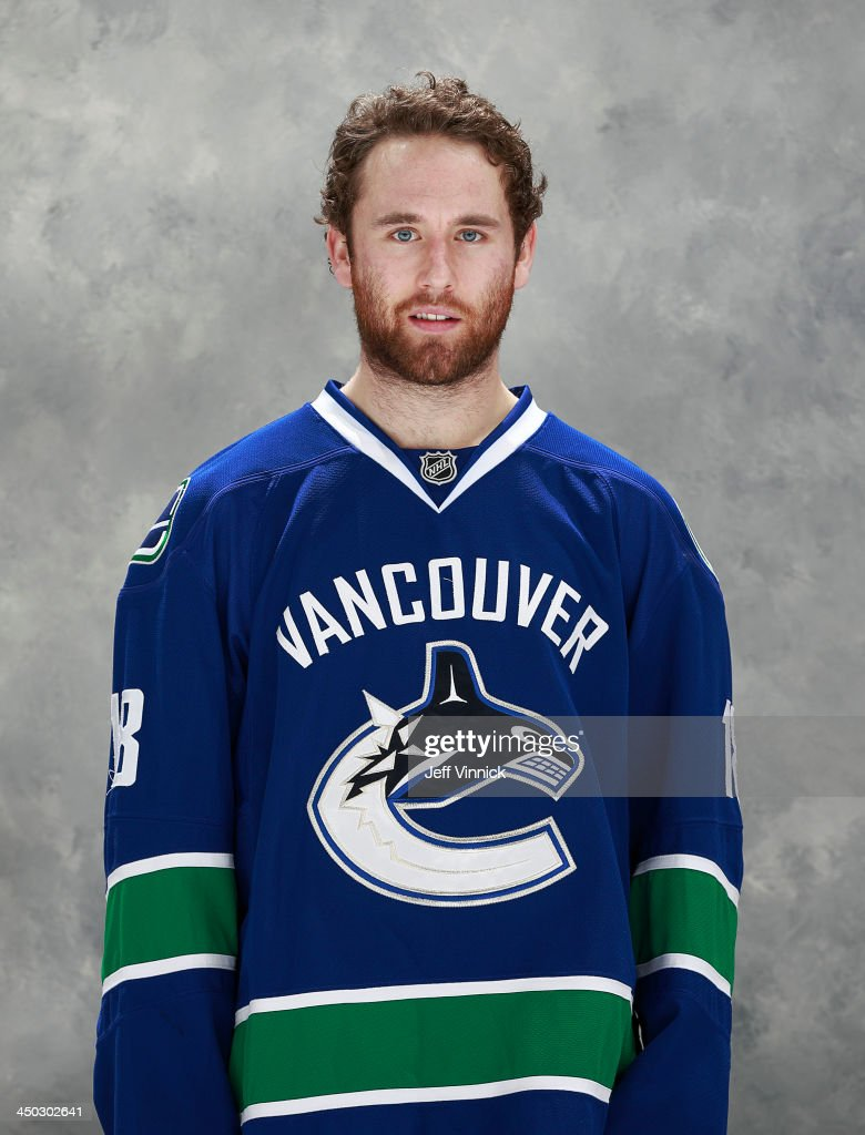 Ryan Stanton #18 of the Vancouver Canucks poses for his official headshot for the 2013-14 NHL season before their NHL game against the Dallas Stars at Rogers Arena on November 17, 2013 in Vancouver, British Columbia, Canada.