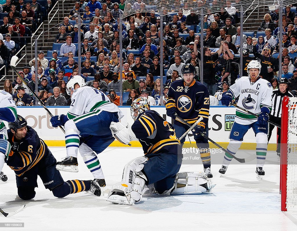 <a gi-track='captionPersonalityLinkClicked' href=/galleries/search?phrase=Ryan+Stanton&family=editorial&specificpeople=7184071 ng-click='$event.stopPropagation()'>Ryan Stanton</a> #18 of the Vancouver Canucks scores a third period goal against the Buffalo Sabres as teammates <a gi-track='captionPersonalityLinkClicked' href=/galleries/search?phrase=Daniel+Sedin&family=editorial&specificpeople=202492 ng-click='$event.stopPropagation()'>Daniel Sedin</a> #22 and <a gi-track='captionPersonalityLinkClicked' href=/galleries/search?phrase=Henrik+Sedin&family=editorial&specificpeople=202574 ng-click='$event.stopPropagation()'>Henrik Sedin</a> #33 battle in front of the net with Mike Weber #6, Ryan Miller #30 and Johan Larsson #22 of Buffalo at First Niagara Center on October 17, 2013 in Buffalo, New York. Vancouver defeated Buffalo 3-0.