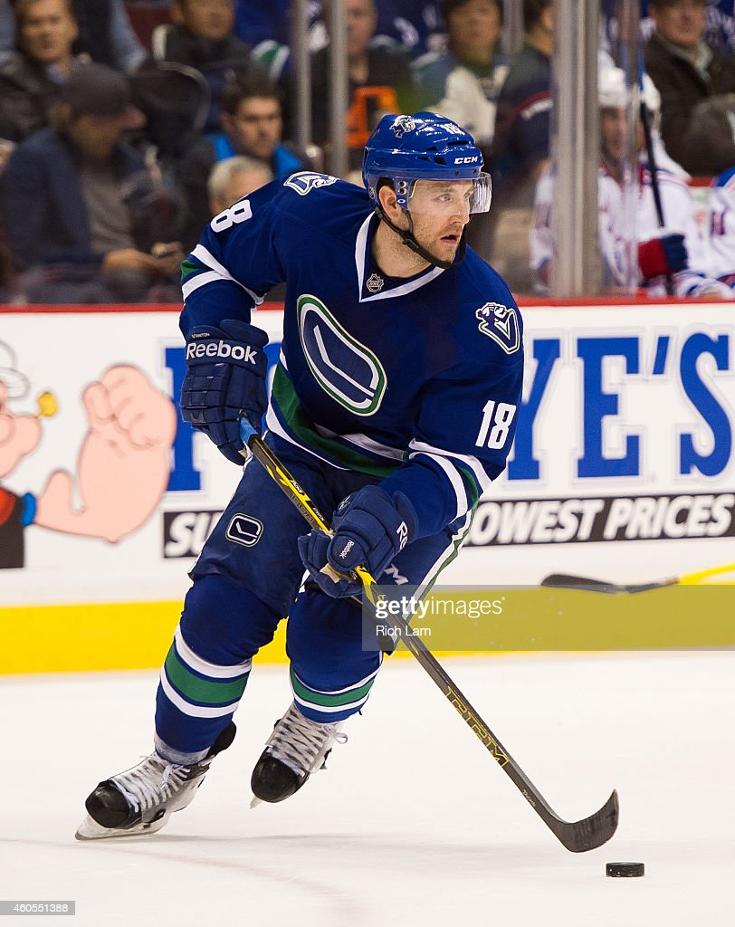 Ryan Stanton of the Vancouver Canucks skates during NHL action against the New York Rangers at Rogers Arena on December 13 2014 in Vancouver British...