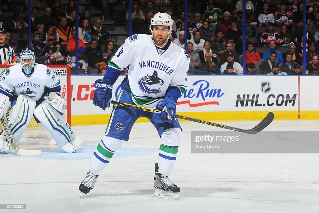 Ryan Stanton of the Vancouver Canucks skates on the ice in a game against the Edmonton Oilers on October 17 2014 at Rexall Place in Edmonton Alberta...