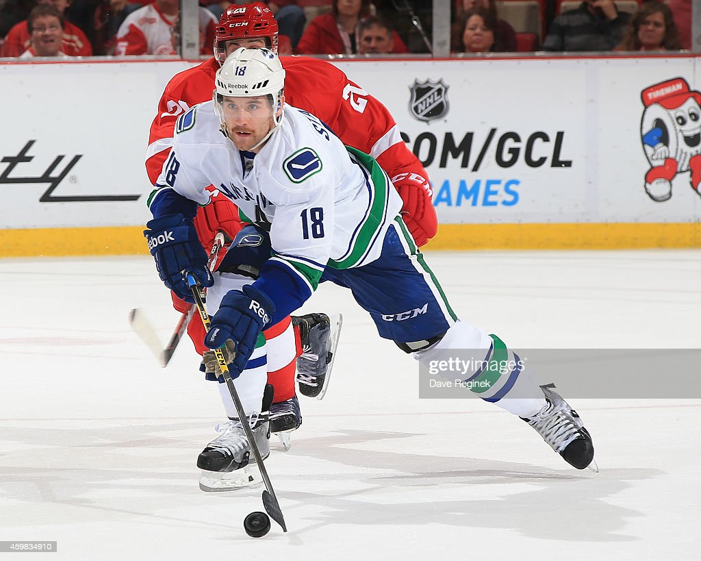 Ryan Stanton of the Vancouver Canucks skates up ice with the puck during a NHL game against the Detroit Red Wings on November 30 2014 at Joe Louis...