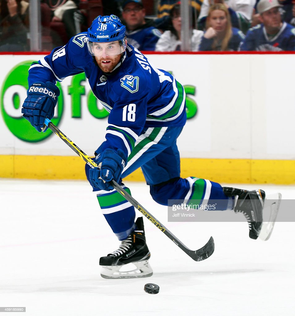 Ryan Stanton of the Vancouver Canucks skates up ice with the puck during their NHL game against the Ottawa Senators at Rogers Arena November 11 2014...