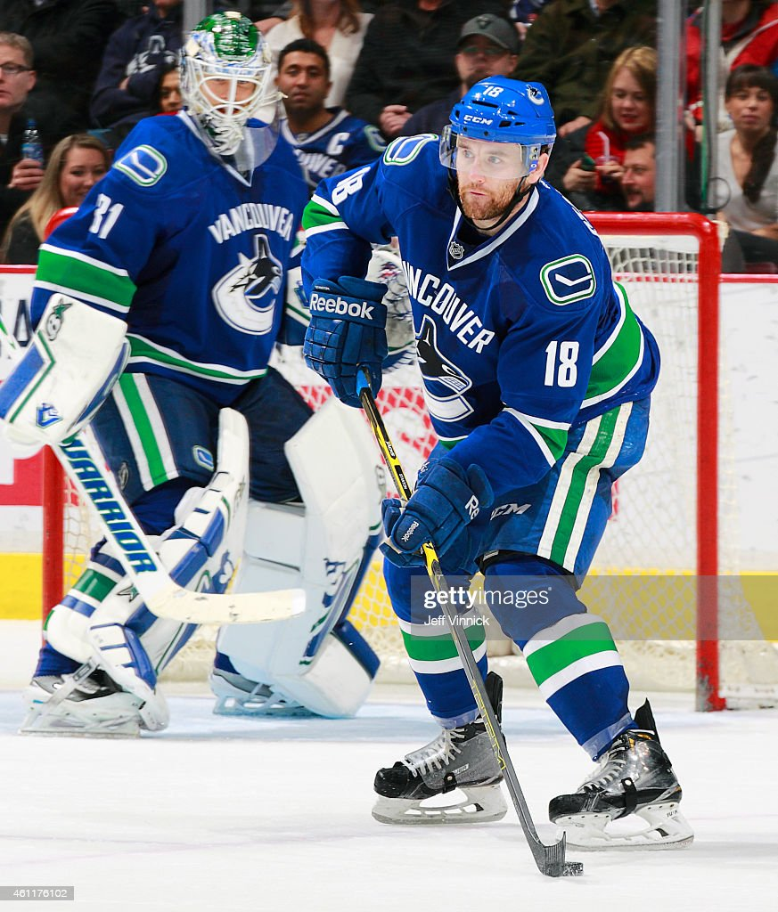 Ryan Stanton of the Vancouver Canucks skates up ice with the puck during their NHL game against the New York Islanders at Rogers Arena January 6 2015...