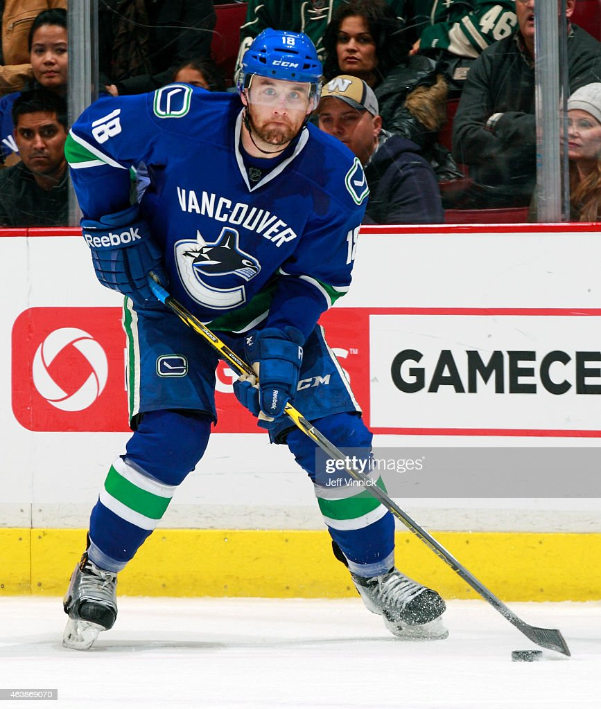 Ryan Stanton of the Vancouver Canucks skates up ice with the puck during their NHL game against the Minnesota Wild at Rogers Arena February 16 2015...