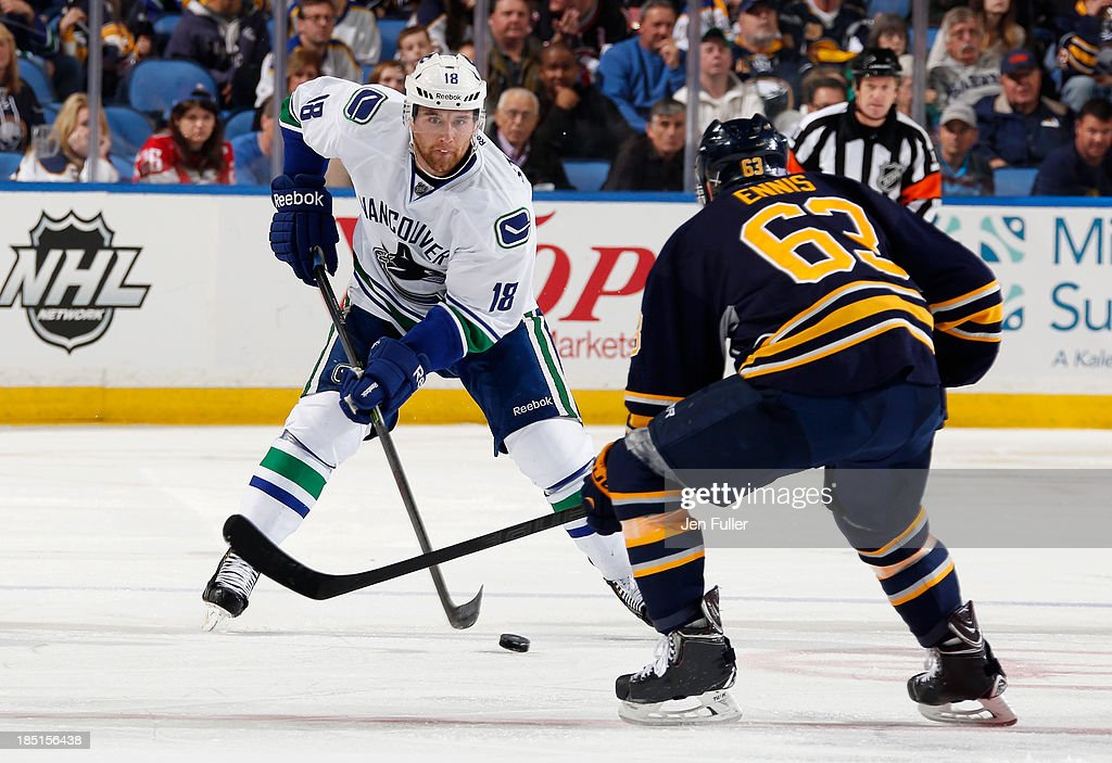 <a gi-track='captionPersonalityLinkClicked' href=/galleries/search?phrase=Ryan+Stanton&family=editorial&specificpeople=7184071 ng-click='$event.stopPropagation()'>Ryan Stanton</a> #18 of the Vancouver Canucks skates with the puck against <a gi-track='captionPersonalityLinkClicked' href=/galleries/search?phrase=Tyler+Ennis+-+Ice+Hockey+Player&family=editorial&specificpeople=4754184 ng-click='$event.stopPropagation()'>Tyler Ennis</a> #63 of the Buffalo Sabres at First Niagara Center on October 17, 2013 in Buffalo, New York. Vancouver defeated Buffalo 3-0.