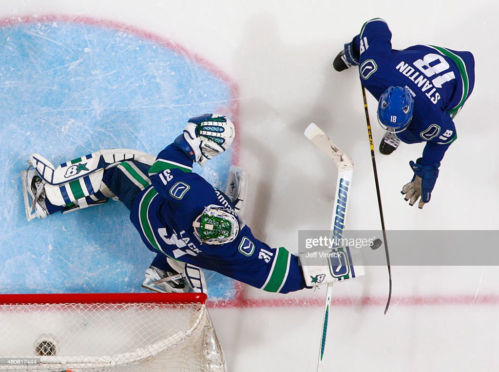Ryan Stanton watches Eddie Lack of the Vancouver Canucks make a save against the Dallas Stars during their NHL game at Rogers Arena December 17 2014...