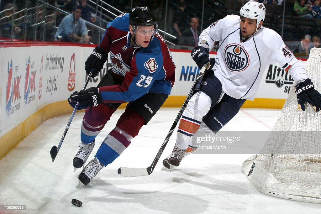 Ryan Stoa #29 of the Colorado Avalanche skates the puck behind his net as Jason Strudwick #43 the Edmonton Oilers follows chase at the Pepsi Center on February 23, 2011 in Denver, Colorado.