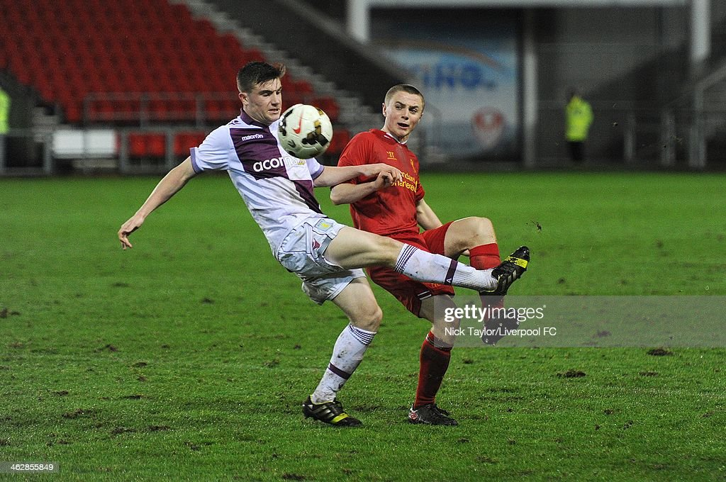 Ryan Strain of Aston Villa and <a gi-track='captionPersonalityLinkClicked' href=/galleries/search?phrase=Jordan+Rossiter&family=editorial&specificpeople=8574887 ng-click='$event.stopPropagation()'>Jordan Rossiter</a> of Liverpool in action during the FA Youth Cup Fourth Round fixture between Liverpool and Aston Villa at Langtree Park on January 15, 2014 in St Helens, England.