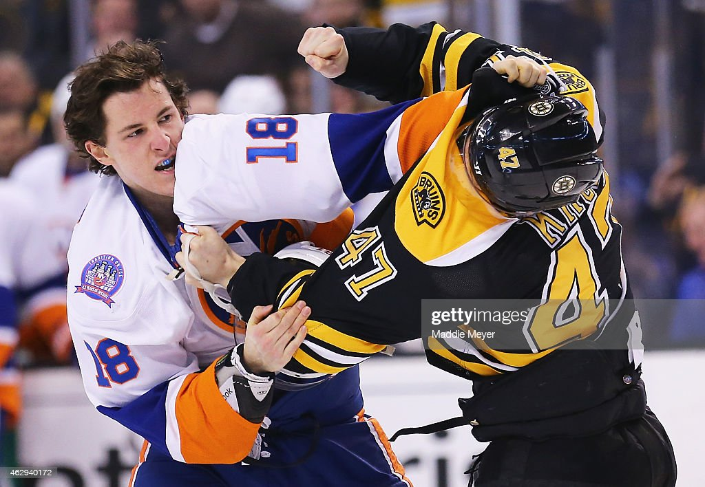 Ryan Strome #18 of the New York Islanders and Torey Krug #47 of the Boston Bruins exchange punches during the first period at TD Garden on February 7, 2015 in Boston, Massachusetts.