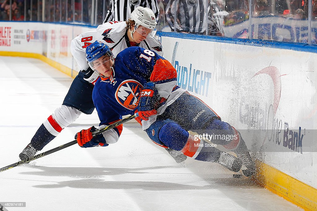 <a gi-track='captionPersonalityLinkClicked' href=/galleries/search?phrase=Ryan+Strome+-+Ice+Hockey+Player&family=editorial&specificpeople=6381535 ng-click='$event.stopPropagation()'>Ryan Strome</a> #18 of the New York Islanders falls to the ice as <a gi-track='captionPersonalityLinkClicked' href=/galleries/search?phrase=Mikhail+Grabovski&family=editorial&specificpeople=2560547 ng-click='$event.stopPropagation()'>Mikhail Grabovski</a> #84 of the Washington Capitals pursues him at Nassau Veterans Memorial Coliseum on April 5, 2014 in Uniondale, New York.