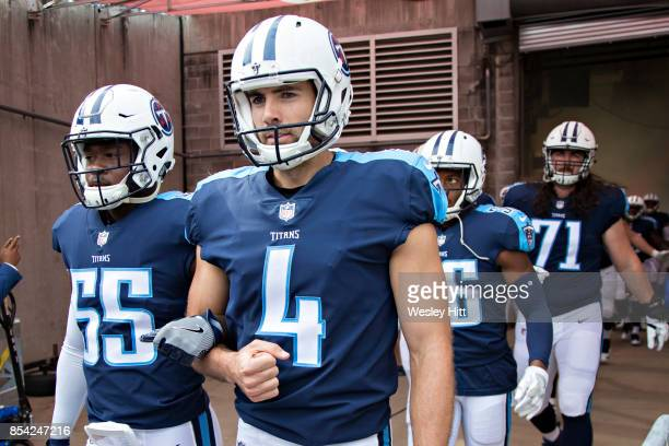 Ryan Succop and Jayon Brown of the Tennessee Titans walk out of the tunnel with arms locked before a game against the Seattle Seahawks at Nissan...