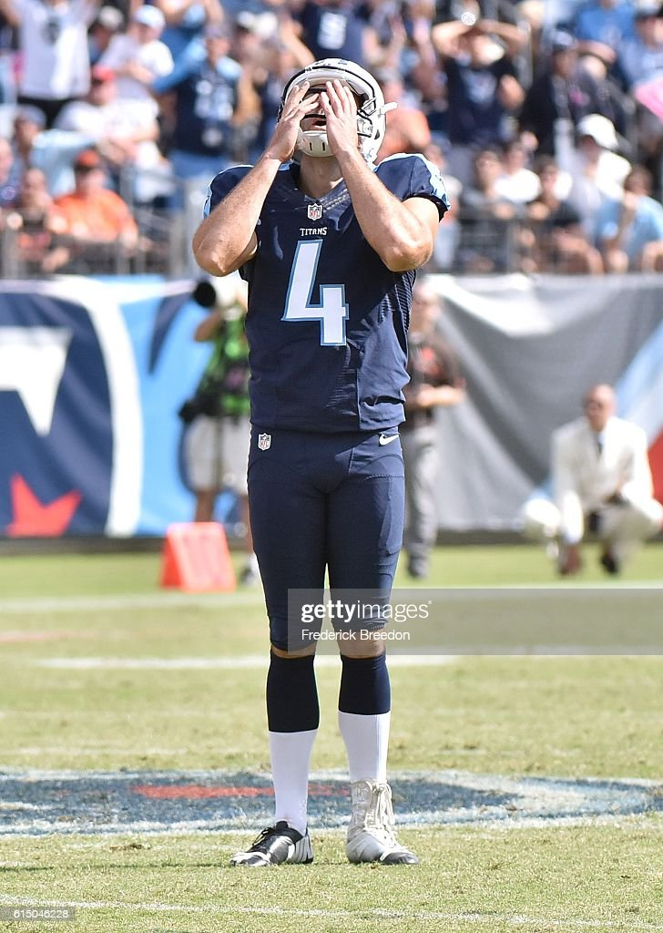 Ryan Succop #4 of the Tennessee Titans reacts after missing a 58 yard field goal against the Cleveland Browns during the first half at Nissan Stadium on October 16, 2016 in Nashville, Tennessee.