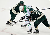 Ryan Suter and Chris Porter of the Minnesota Wild go after the puck with Valeri Nichushkin of the Dallas Stars during the third period of Game Four...