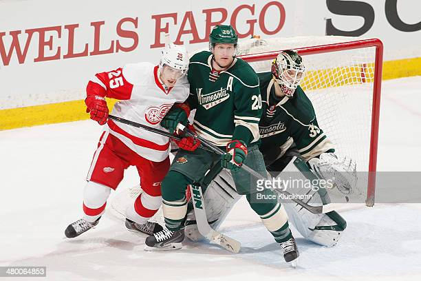 Ryan Suter and goalie Darcy Kuemper of the Minnesota Wild defend their goal against Cory Emmerton and the Detroit Red Wings during the game on March...