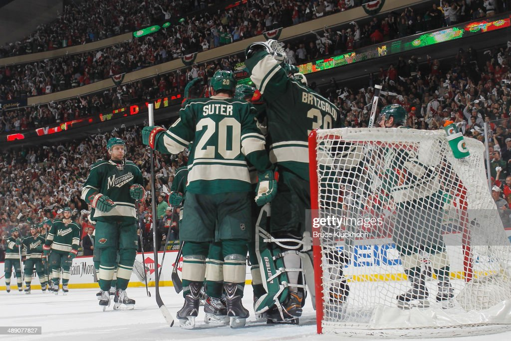 Ryan Suter #20 and Ilya Bryzgalov #30 celebrate with their Minnesota Wild teammates after defeating the Chicago Blackhawks in Game Four of the Second Round of the 2014 Stanley Cup Playoffs on May 9, 2014 at the Xcel Energy Center in St. Paul, Minnesota.