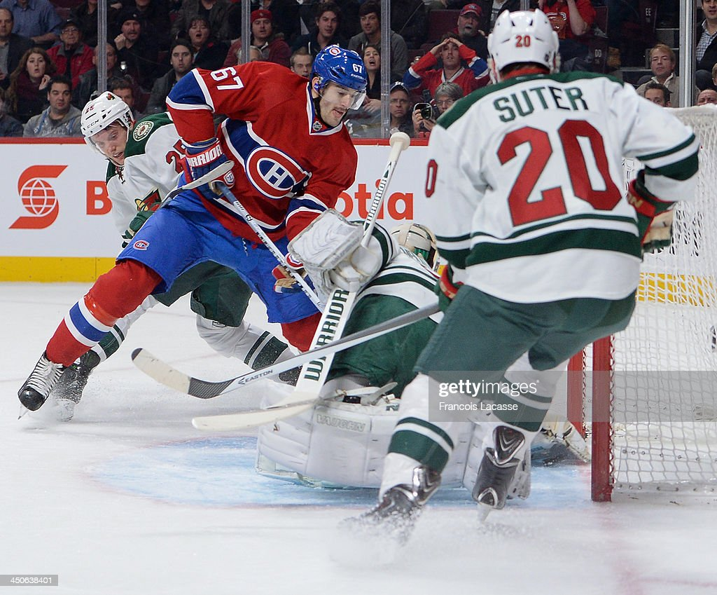 Ryan Suter #20 and Jonas Brodin #25 of the Minnesota Wild protect the net against Max Pacioretty #67 of the Montreal Canadiens during the NHL game on November 19, 2013 at the Bell Centre in Montreal, Quebec, Canada.