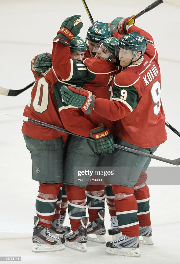 <a gi-track='captionPersonalityLinkClicked' href=/galleries/search?phrase=Ryan+Suter&family=editorial&specificpeople=583306 ng-click='$event.stopPropagation()'>Ryan Suter</a> #20, Charlie Coyle #63, <a gi-track='captionPersonalityLinkClicked' href=/galleries/search?phrase=Zach+Parise&family=editorial&specificpeople=213606 ng-click='$event.stopPropagation()'>Zach Parise</a> #11 and <a gi-track='captionPersonalityLinkClicked' href=/galleries/search?phrase=Mikko+Koivu&family=editorial&specificpeople=584987 ng-click='$event.stopPropagation()'>Mikko Koivu</a> #9 of the Minnesota Wild celebrate the game tying goal by Suter in the final minute of the third period of the game against the Phoenix Coyotes on March 27, 2013 at Xcel Energy Center in St Paul, Minnesota. The Wild defeated the Coyotes 4-3 in overtime.